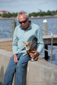man and chihuahua at paws in motion 2021