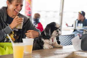 dog enjoying a drink at paws in motion 2021